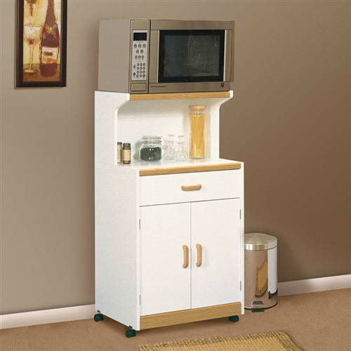 This White Microwave Cart with Natural Wood Finish Accents and Sturdy Dual Wheel Casters would be a great addition to your home. Features accessory storage area and drawer for utensils. Sturdy dual wheel casters roll easily; Assembly Required; Countertop Other Countertops; Feature Locking Casters, Microwave; Shelf Finish Soft White; Material Laminate; Style Traditional; Type Microwave Shelf.