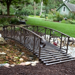 8-Ft Metal Garden Bridge in Weathered Black Finish - 750-lb Weight Capacity, CWMB1856485 :  Want a unique garden accent the neighbors won't have but wish they did? Look no further than this 8-Ft Metal Garden Bridge in Weathered Black Finish - 750-lb Weight Capacity. Finely crafted of steel for stability, this 8-foot garden bridge features decorative, wrought iron scrolls on the ends of each railing and foliage-inspired details on the sides. It has a rustic, distressed black finish that's epoxy-coated for weather-resistance. This bridge has a 750-pound weight capacity. Rustic, weathered black finish; Decorative leaf details; Bridge Length (ft.) 8; Material Steel; Rail Type One Rail.
