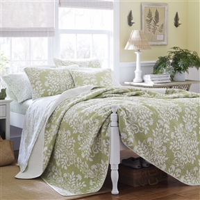 This King size 100% Cotton 3 Piece Quilt Set in Sage Green White Floral Pattern combines the splendor of damask with the timeless quality of quilting to create high style. The white floral damask runs in close vertical rows up a blue background. The print on the reverse offers a change of pace with a small geometric design. It's perfect as an addition to existing bedding or on its own. Pattern: Nature/Floral; Material: Cotton; Gender: Female; Life Stage: Adult.