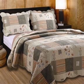 This Twin size 100% Cotton Oversized Quilt Set with Sham Southwest Style would be a great addition to your home. It is oversized for better mattress coverage and printed to look pieced. Wildflowers combine with warm stripes; Scalloped edges with intricate vermicelli quilting provides a rich surface texture; Machine washable; Twin set includes 1 quilt and 1 sham; Full/Queen and King set includes 1 quilt and 2 shams; Crafted in the colors of the great Southwest; Sham Material: Cotton; Reverse Side Material: Cotton; Pattern: Nature/Floral.