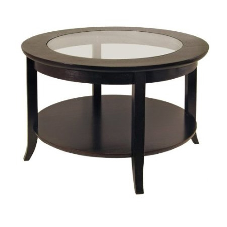 Elegantly design with glass top, this Circular Round Espresso Finish Coffee Table with Glass Inset. Its flared leg, shelf blends well with any style of room decor. Or match with same collection round side table.