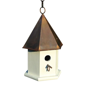 "White Wood Songbird Birdhouse with Brown Copper Roof, HCSWBH7746 :  This White Wood Songbird Birdhouse with Brown Copper Roof has a stylish hexagonal body of solid cypress and a six sided roof. Remove roof and clean out debris, spray with a mild bleach and water solution then rinse thoroughly and let dry in the sun. Hanging loop and matching copper perch complete the look, with easy cleanout and optional mounting; Clean outs, ventilation and drainage built in; Hand crafted in the USA; Details: Handcrafted of solid cypress; Weather Resistant Details: Weather resistant finish; Tools Needed for Assembly: Screwdriver and drill; Parts Needed: Chain or rope for hanging or screws and plate with post for mounting; Product Warranty: Lifetime. Nesting Height: 60""-72"" or higher Feet; Outdoor Use: Place in a spot with afternoon shade; Animal Capacity: Enough room for 1 family of birds; Country of Manufacture: United States."