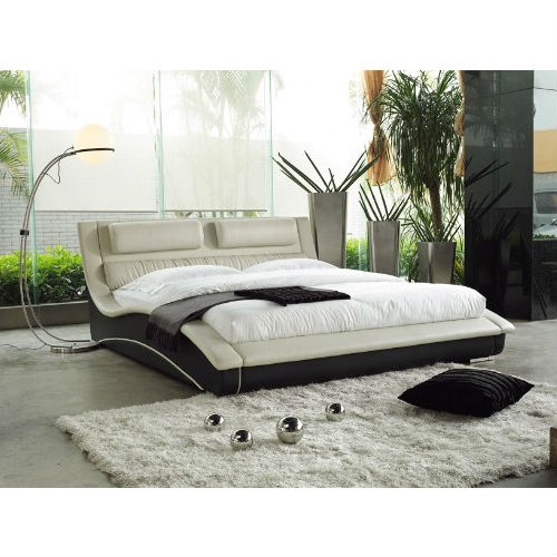 This Queen size Modern Curvy Upholstered Platform Bed with Headboard in Cream Black Faux Leather is an artistic expression in contemporary furniture design. This attractive and charming bed provides both comfort and relaxation.All wooden frame and upholstered in high quality leatherette. Mattress is supported by Slats.This bed requires US standard Queen size mattress. Mattress is not included. matching night stands and Dresser can be purchased separately.
