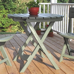 Sage Green Folding Patio Dining Cafe Table in Lightweight Sturdy Resin, GFPT87954 :  This Sage Green Folding Patio Dining Cafe Table in Lightweight Sturdy Resin works well for small parties on the patio or deck. It's also handy beside the grill or to hold food and drinks at picnics. At game time, the Cafe Table is the perfect portable tailgating table. Built in umbrella hole holds most standard umbrellas; Cleaning is simple, just wipe with a damp cloth; Folds quickly and compactly for storage; Lightweight and durable material that will not peel, rust, or rot; Made in USA; Material: High-quality resin; Rated to hold 40 lbs; UV inhibitor allows colors to stay bright and attractive in the sun; Table Shape: Rectangle; Product Type: Bistro table; Style: Contemporary; Seating Capacity: 4; Table Weight Capacity: 40 Pounds; Commercial Use: No; Product Warranty: 1 Year warranty against manufacturer's defects.