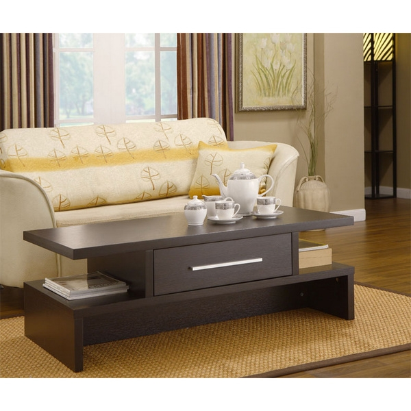 """This Guchi Modern Coffee Table with 39"""" Square Tempered Glass Top consists of 4 basic parts a beautiful glass top and 4 interlocking wood base pieces. This is very similar to the classic design that was first produced in 1944."""