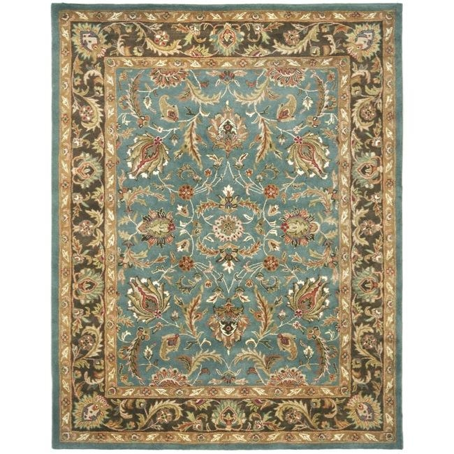 Handmade Heritage Blue/ Brown Wool Rug (9'6 x 13'6), 1HHBBWR96136 :  An intricate Oriental design with a dense, thick pile height complete the look and feel of this vibrant rug. This Handmade Heritage Blue/ Brown Wool Rug (9'6 x 13'6) is handmade from luxuriant wool and features a sturdy canvas backing for superior durability. Tip: We recommend the use of a non-skid pad to keep the rug in place on smooth surfaces. All rug sizes are approximate. Due to the difference of monitor colors, some rug colors may vary slightly. We try to represent all rug colors accurately. Please refer to the text above for a description of the colors shown in the photo. Style: Traditional; Primary color: Blue; Pattern: Oriental.