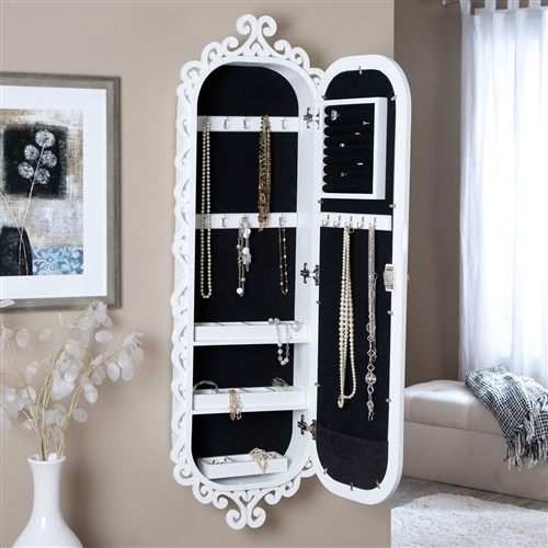 Wall Mounted Jewelry Cabinet Mirror Armoire with Gloss White Scrolling Border, WLJA5198415 :  Combine artistic beauty and incredible functionality with this Wall Mounted Jewelry Cabinet Mirror Armoire with Gloss White Scrolling Border. The armoire has an antique feel, with a high-gloss white finish, scrollwork edges, and a lock and key to keep your belongings secure. The door, which features a mirrored front, has a cushion for rings, hooks for necklaces and bracelets, and box compartments for earrings and other loose items on the back. The armoire also has three removable storage trays that are compartmentalized for your convenience, so you'll always be able to find your accessories when you need them. Ring cushion, necklace hooks, 11 small compartments; Finish High Gloss, Black; Style Modern / Contemporary.
