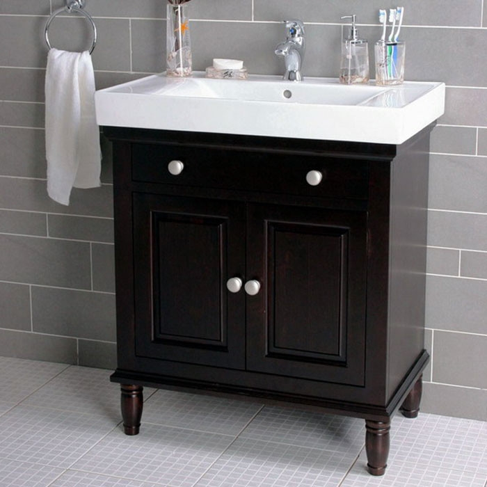 Single Bathroom Vanity Set in Dark Brown Wood w/ White Sink, L30SBV71661 :  A traditional vanity with a modern flair adds style and sophistication to your relaxing and romantic bathroom. This Single Bathroom Vanity Set in Dark Brown Wood w/ White Sink features a luxurious white top with sink. Designed two doors open to reveal enhanced storage. A complete unit that is ready to install. White porcelain sink with white top; Burnished hardware; Features a luxurious white top with sink; Two doors with durable concealed hinges; Contemporary European design sink; Corner support blocks for additional stability; All accessories not included; Solid hardwood and wood veneer construction; Dark brown finish; Double-glazed sink with nano finish provides a smooth surface that repels water; Manufacturer provides one year defect warranty; Style: Contemporary; Top Material Details: Porcelain; Number of Doors: 2; Number of False Drawers: 1; Sink Shape: Rectangular;  Product Warranty: 1 Year warranty for defects.  Basin Depth - Top to Bottom: 5 Inches; Basin Width - Front to Back: 10.5 Inches; Basin Length - Side to Side: 17 Inches; Overall Sink Width - Front to Back: 14.25 Inches; Overall Sink Length - Side to Side: 30 Inches; Faucet Hole Diameter: 1.375 Inches; Overall Height - Top to Bottom: 35.25 Inches;  Overall Width - Side to Side: 30 Inches; Overall Depth - Front to Back: 18.25 Inches; Base Height - Top to Bottom: 31.5 Inches; Base Width - Side to Side: 28.625 Inches; Base Depth - Front to Back: 17 Inches; Drain Connection Diameter: 1.875 Inches; Overall Product Weight: 68lbs. Base Weight: 50lbs. Top Weight: 54lbs.
