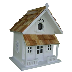 "White Victorian Cottage Wooden Birdhouse - Fully Assembled, WVCBH3799 :  A pine shingled roof, a covered porch and ""Cottage"" styling give this White Victorian Cottage Wooden Birdhouse - Fully Assembled plenty of charm. A removable back wall, drainage, ventilation, an unpainted interior and a 1-1/4-inch hole size will invite nesting birds in and keep larger ones out. House can be hung with mounting peg (included)."
