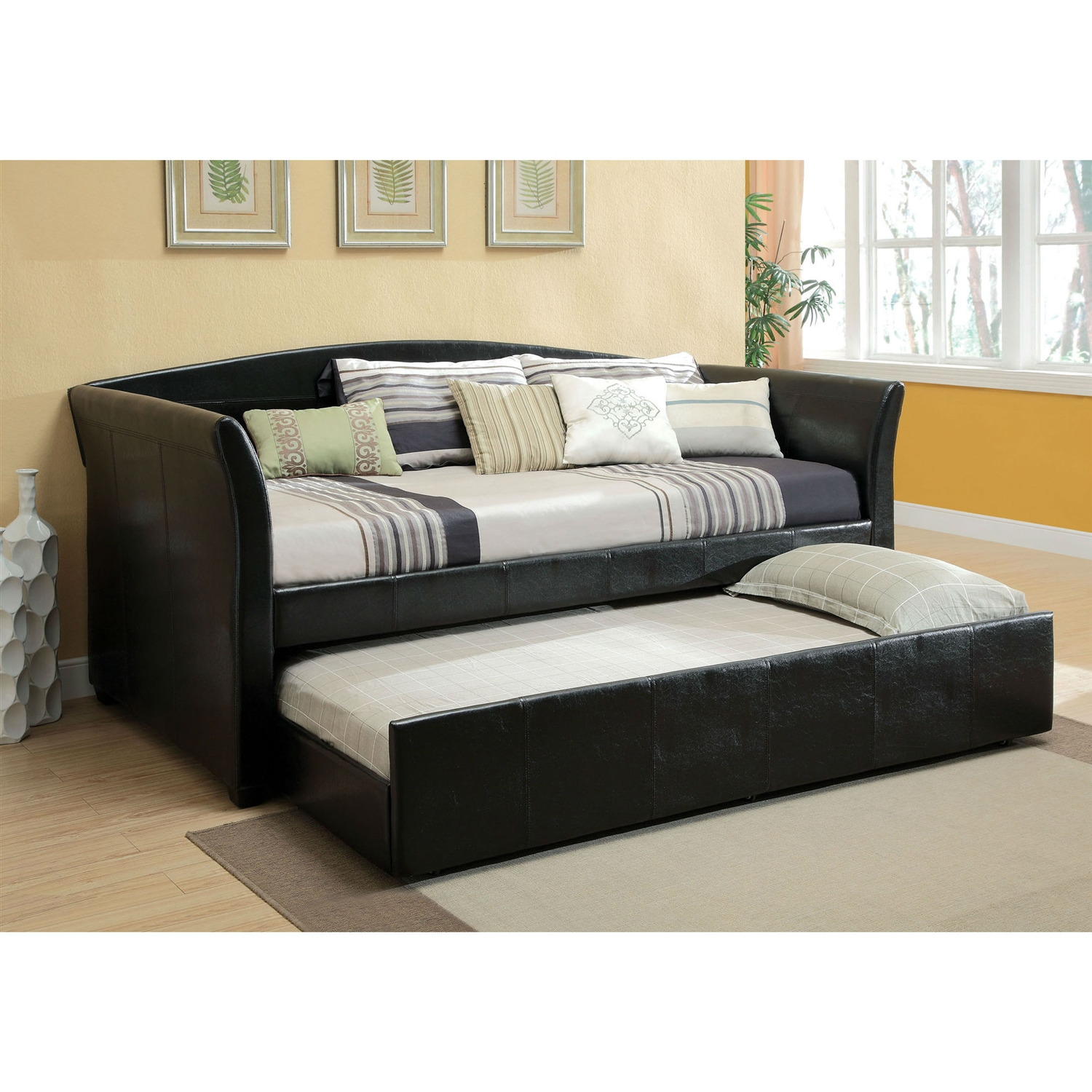 Twin size Modern Black Faux Leather Daybed with Trundle: Product Code: HDRDTB783 : Perfect addition to a guestroom, den or kids room. This Twin size Modern Black Faux Leather Daybed with Trundle is outfitted with a hidden trundle with casters for easy roll out. Constructed out of solid wood and posh leatherette upholstery. Padded cushioning on back and arm panels, making it an inviting spot to relax; Twin roll-out trundle that is an ideal space saver, great for slipovers; Slats support system, slat kit included; Great structural rigidity; Modern style; 30 Days warranty.