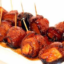 Bourbon Glazed Grilled Pineapple Wrapped in Thinly Sliced Ham with Black Pepper. 24 count