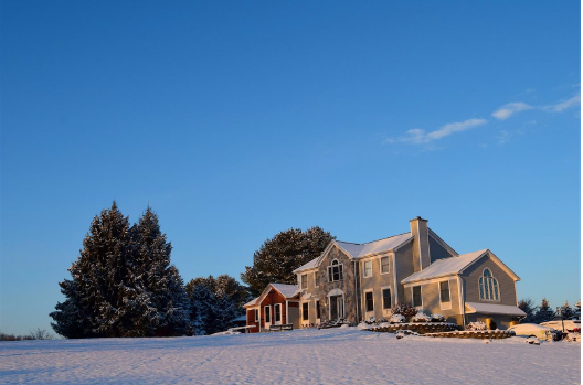 Large home in snowy field