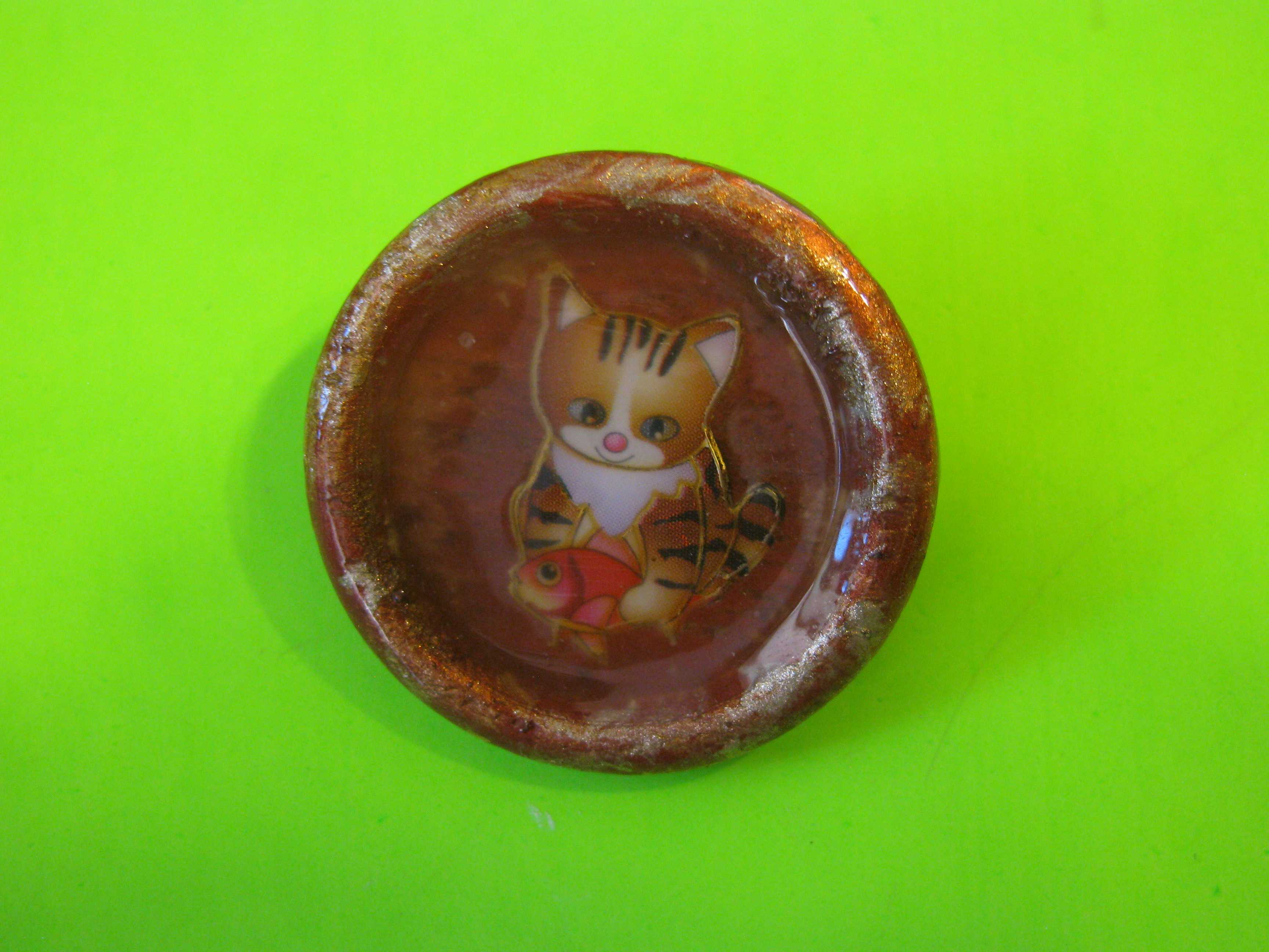 Cartoon Style Cat Holding a Fish on Circular Plastic Button with Loop Shank