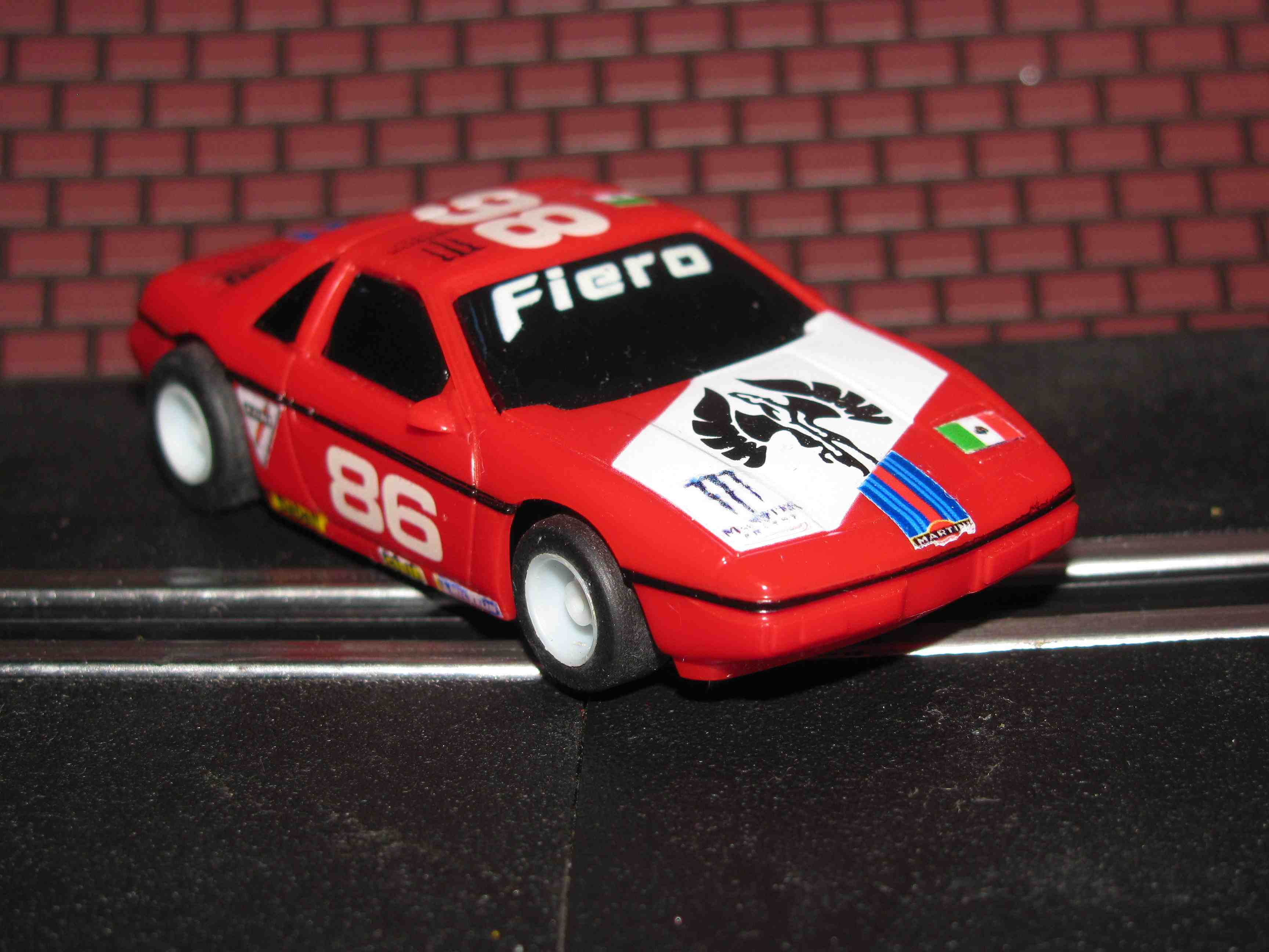 *SOLD* TYCO Pontiac Fiero - HO Slot Car – Red - Car#86 – W/Guide Post