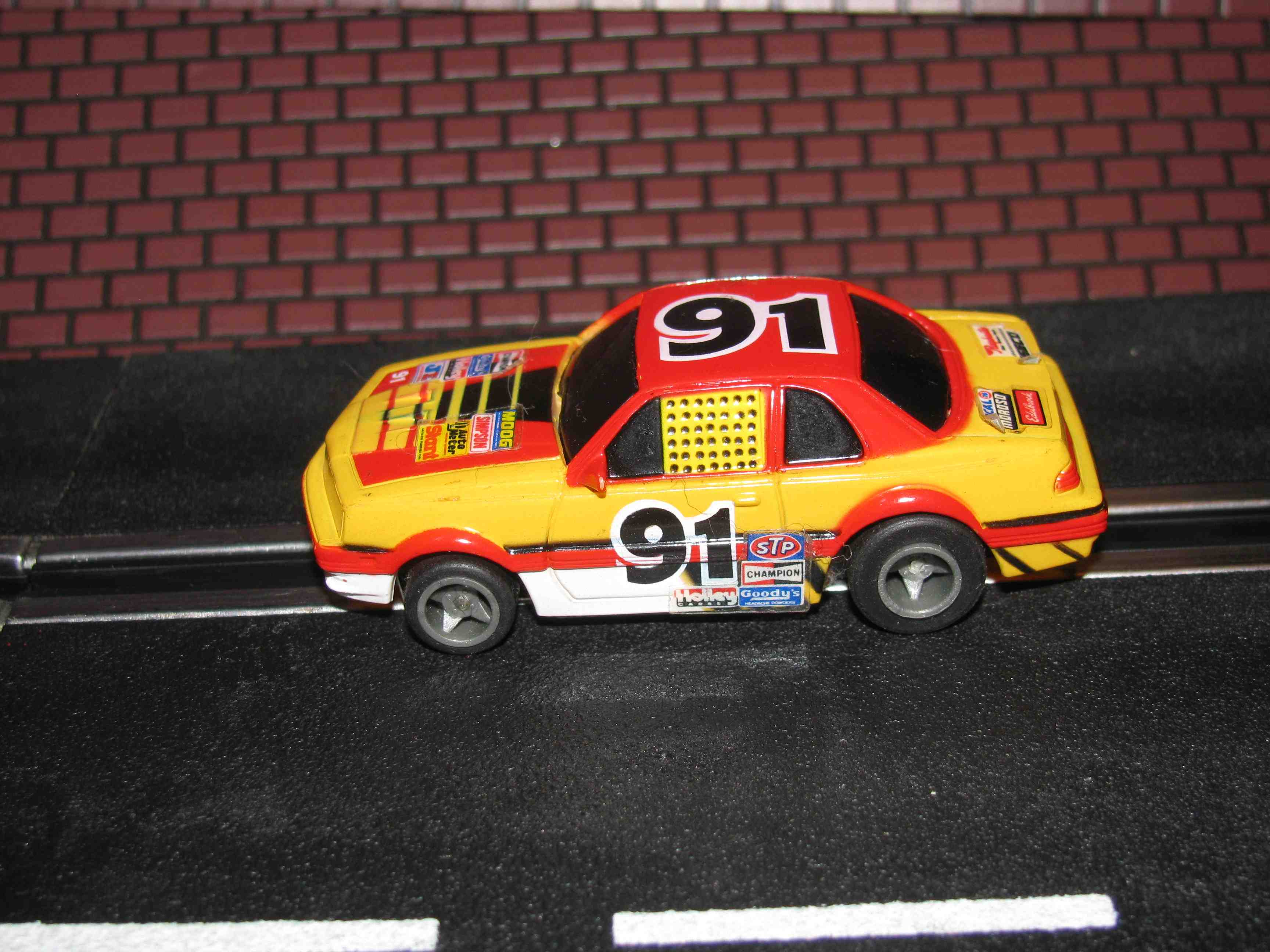 * SOLD * Tyco Like-Like HO Slot Car #91 Rokar (Ford T-Bird) with Guide Post