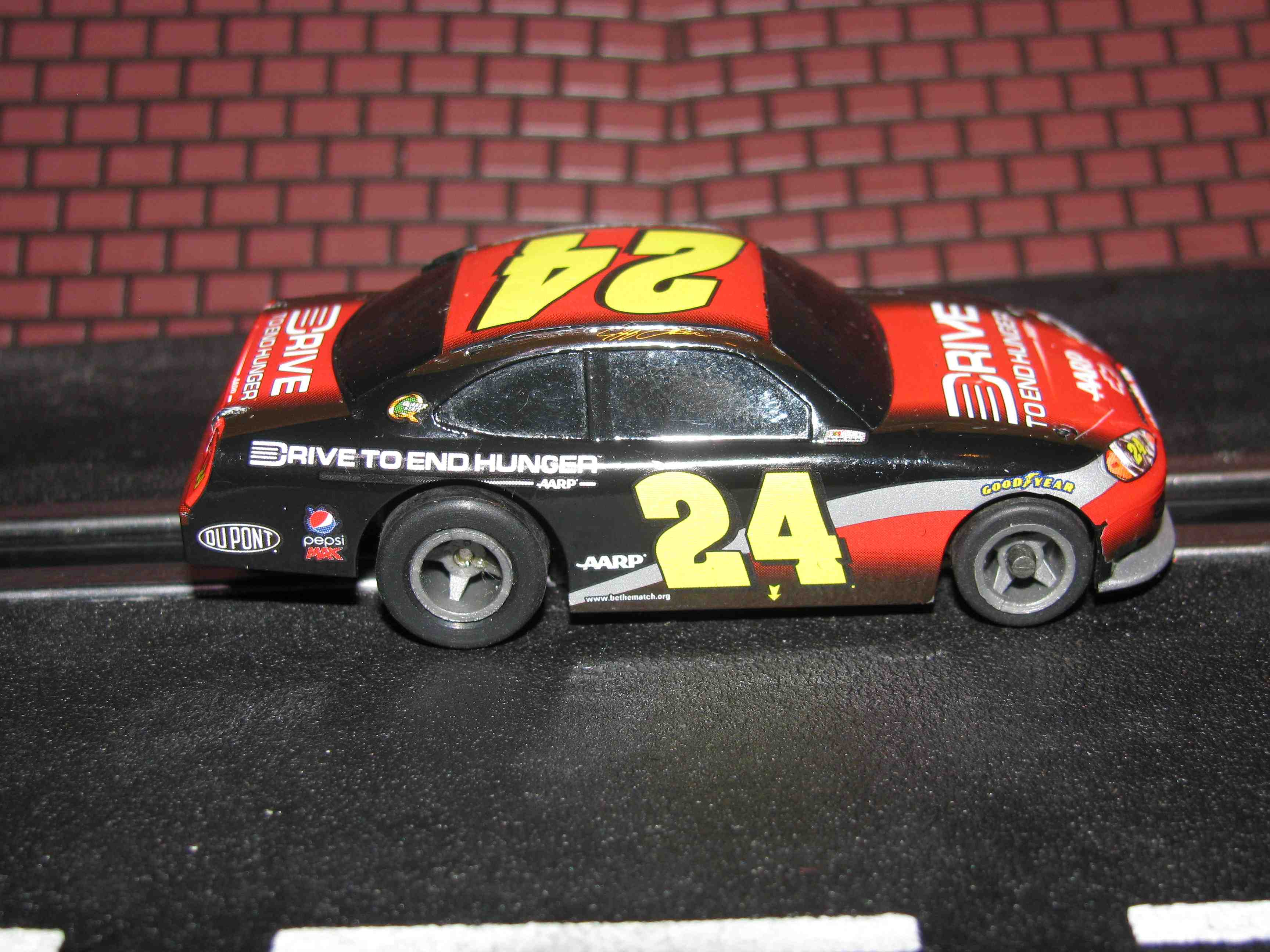 * SOLD * Tyco Like-Like HO Slot Car #24 Chevy Impala (Drive To End Hunger) with Guide Post