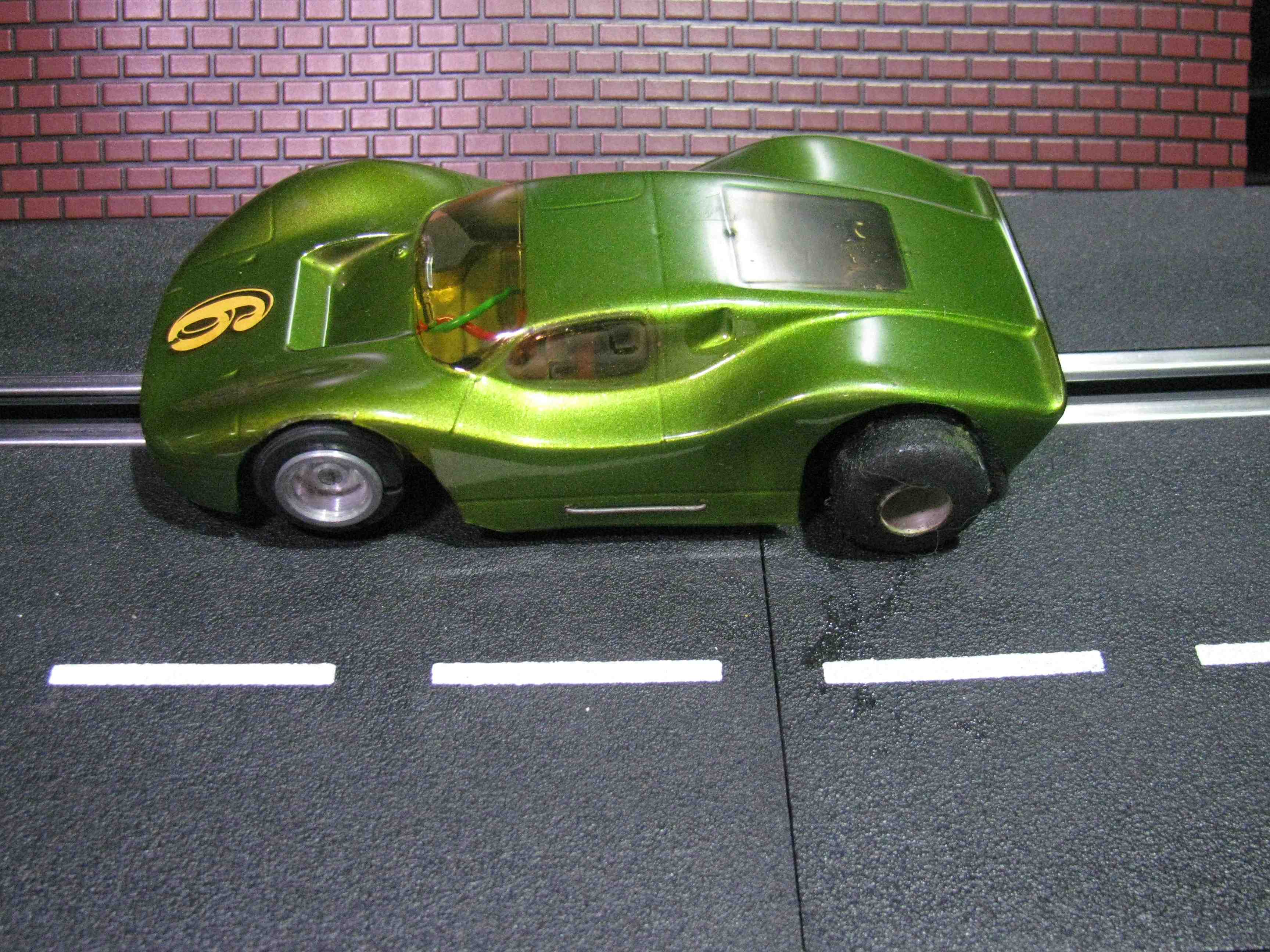 * SOLD * Vintage 1/32 Scale Slot Car in a classic green with Solid Chassis