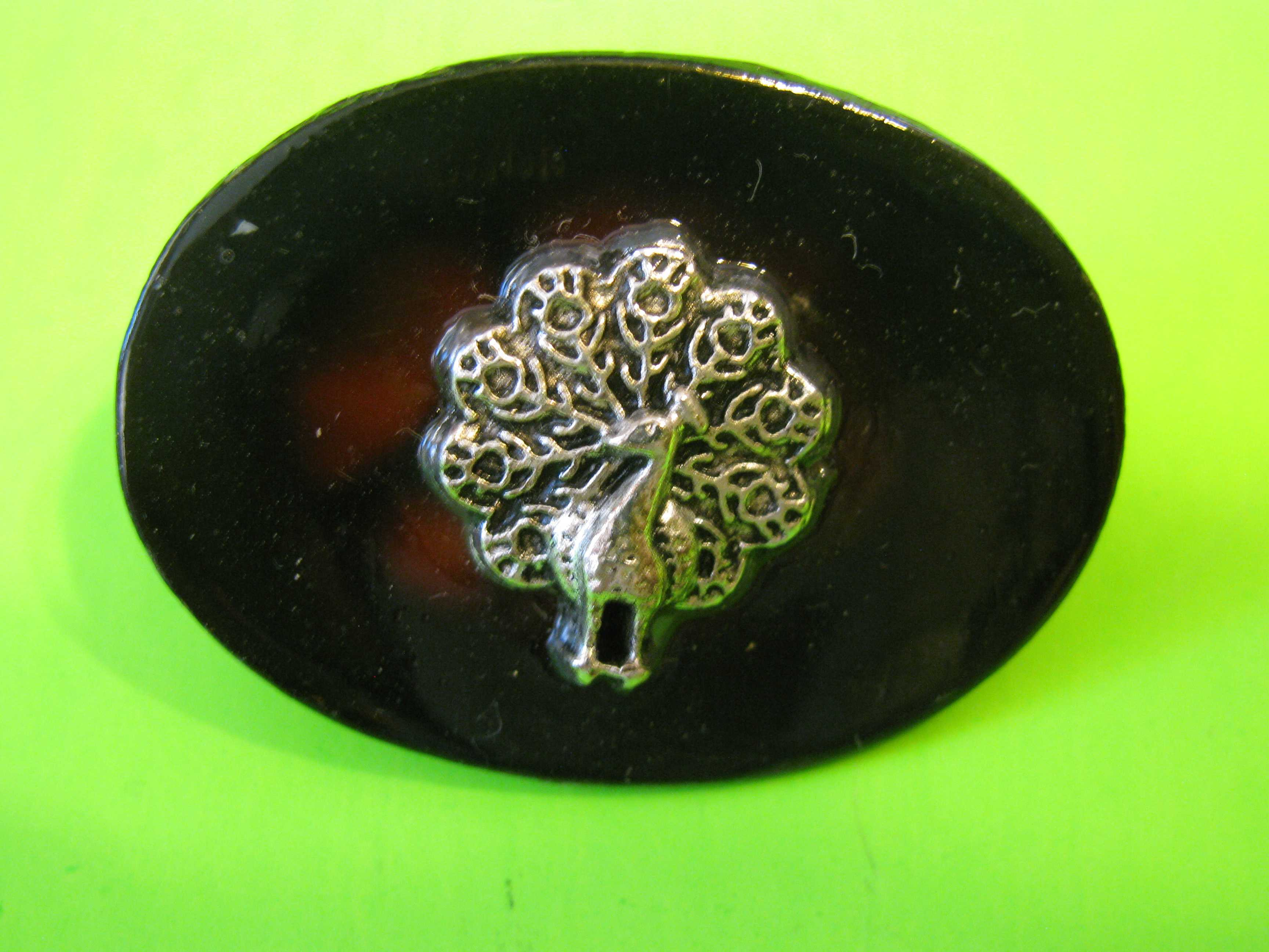 Oval Faux Tortoise with Silver Peacock in Beautifully Carved Wood