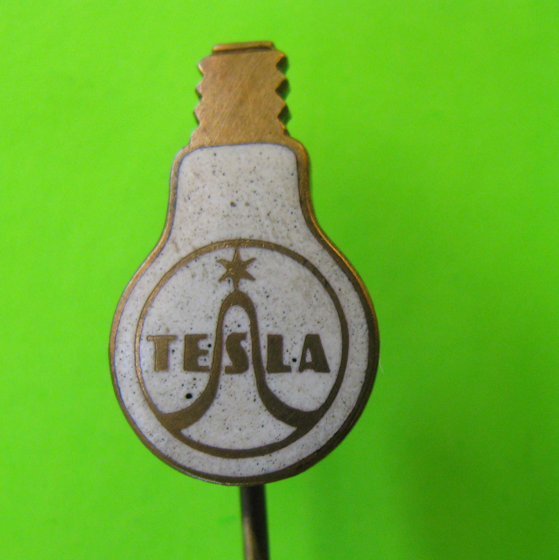 Vintage Tesla Stick Pin, Metal with White Colored Light Bulb Background