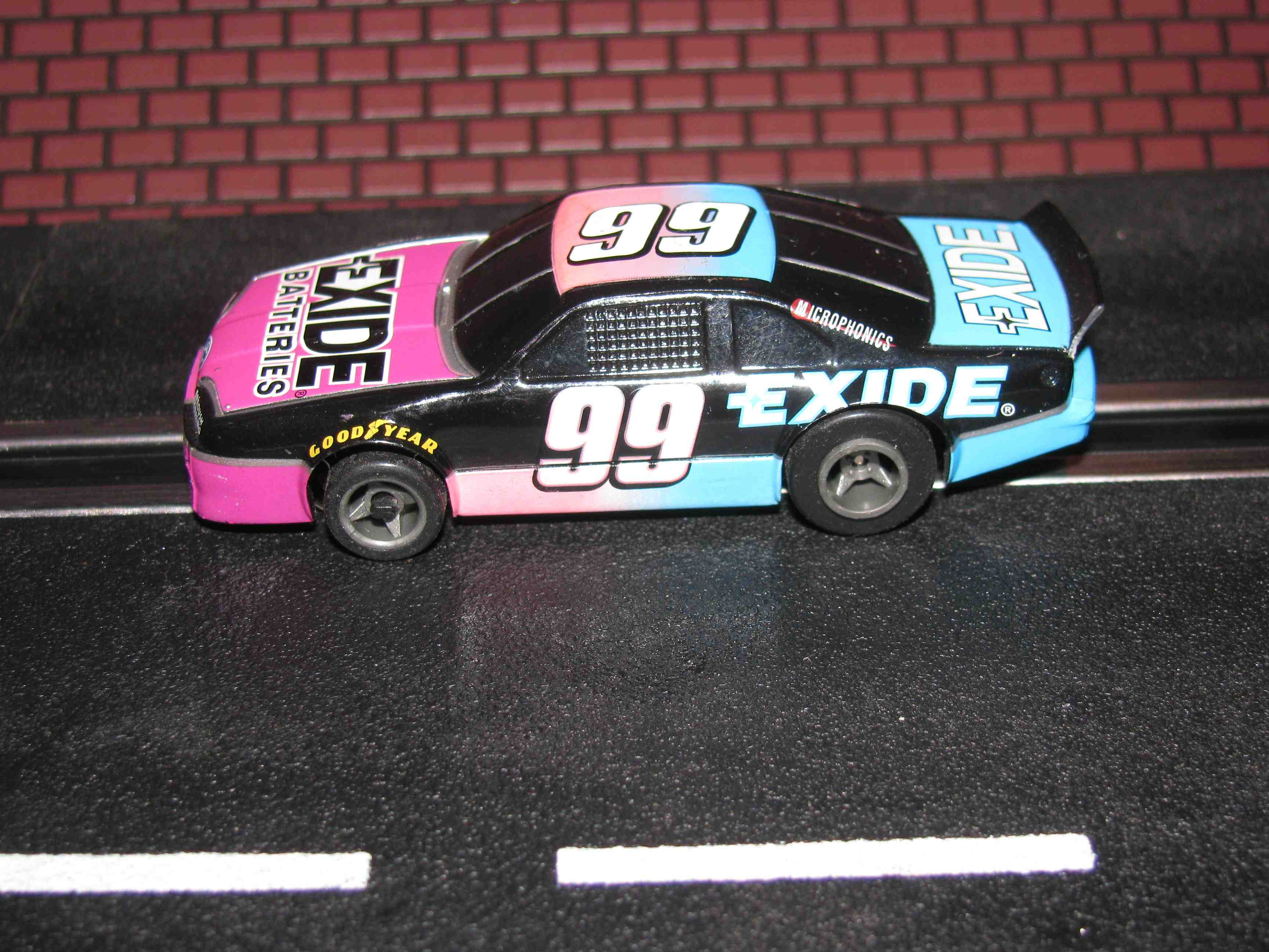 * SOLD * Tyco Like-Like HO Slot Car #99 Ford T-Bird (Exide Batteries) with Guide Post