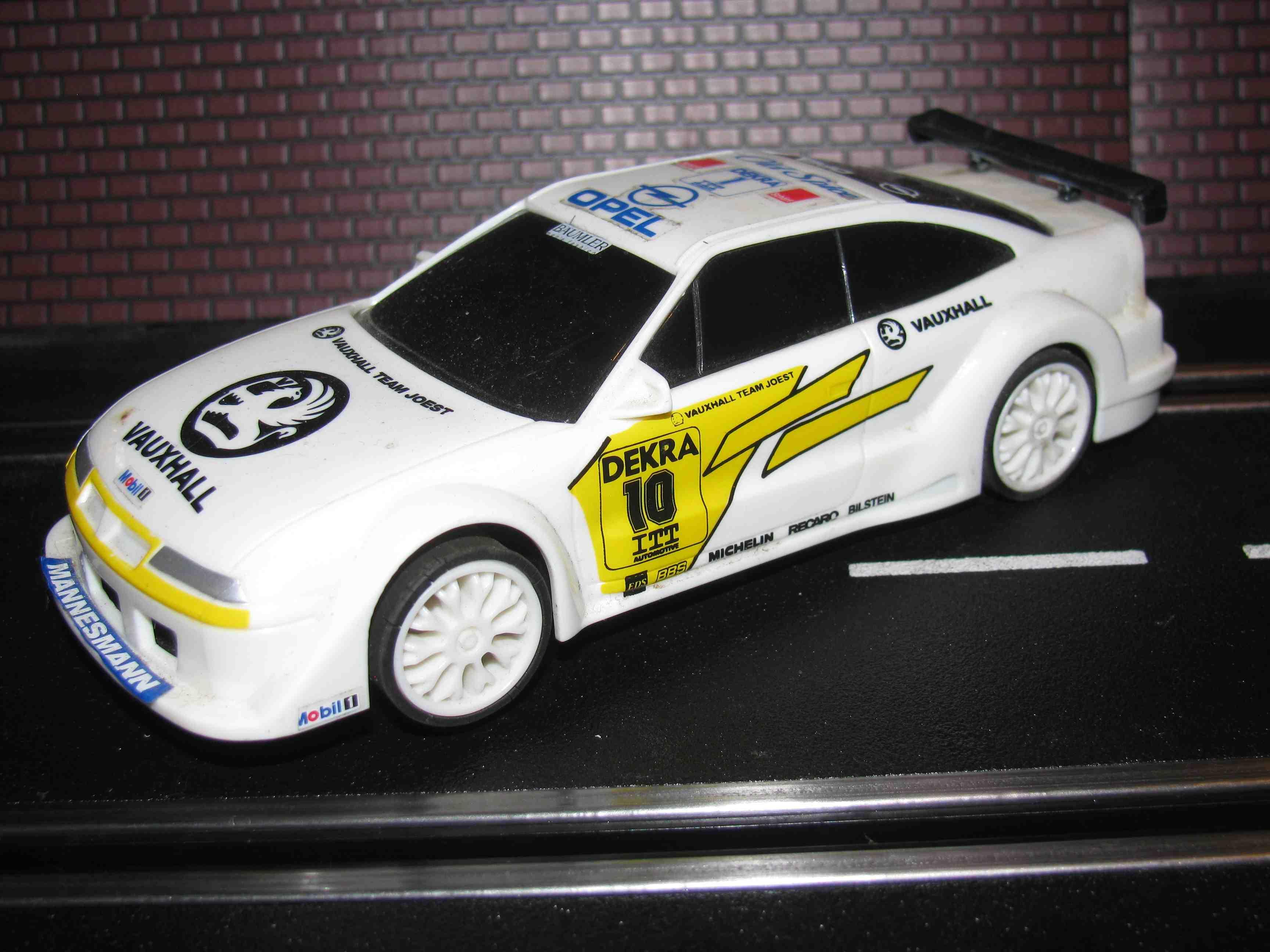 Hornby/SCX D2 OPEL Vauxhall Team Joest DEKRA Racer Slot Car 1/32 Scale, White, Car 10