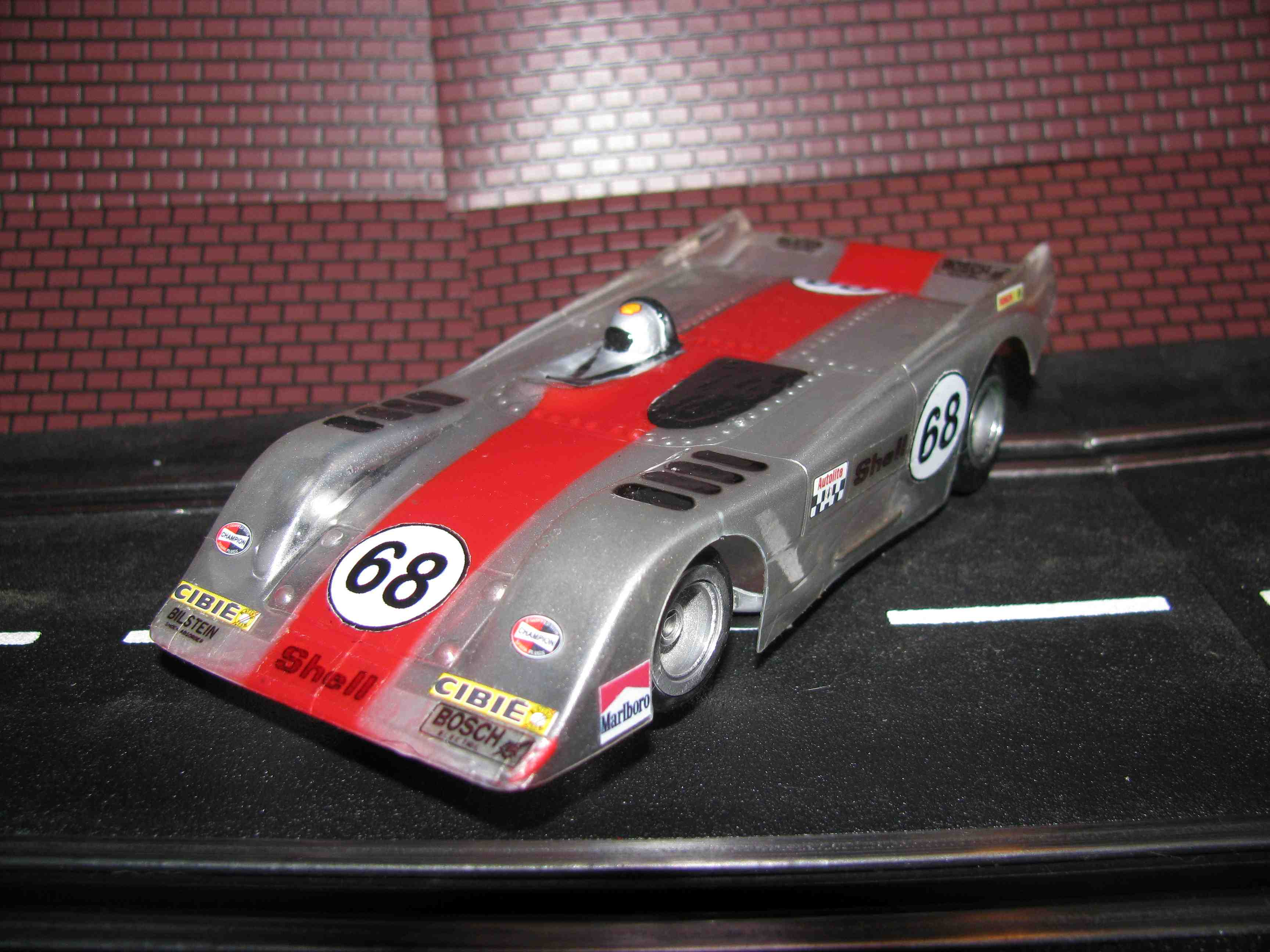 * SOLD * RIGGEN Vintage CANAM PRO-AM Slot Car in Silver with classic single red stripe – Car 68