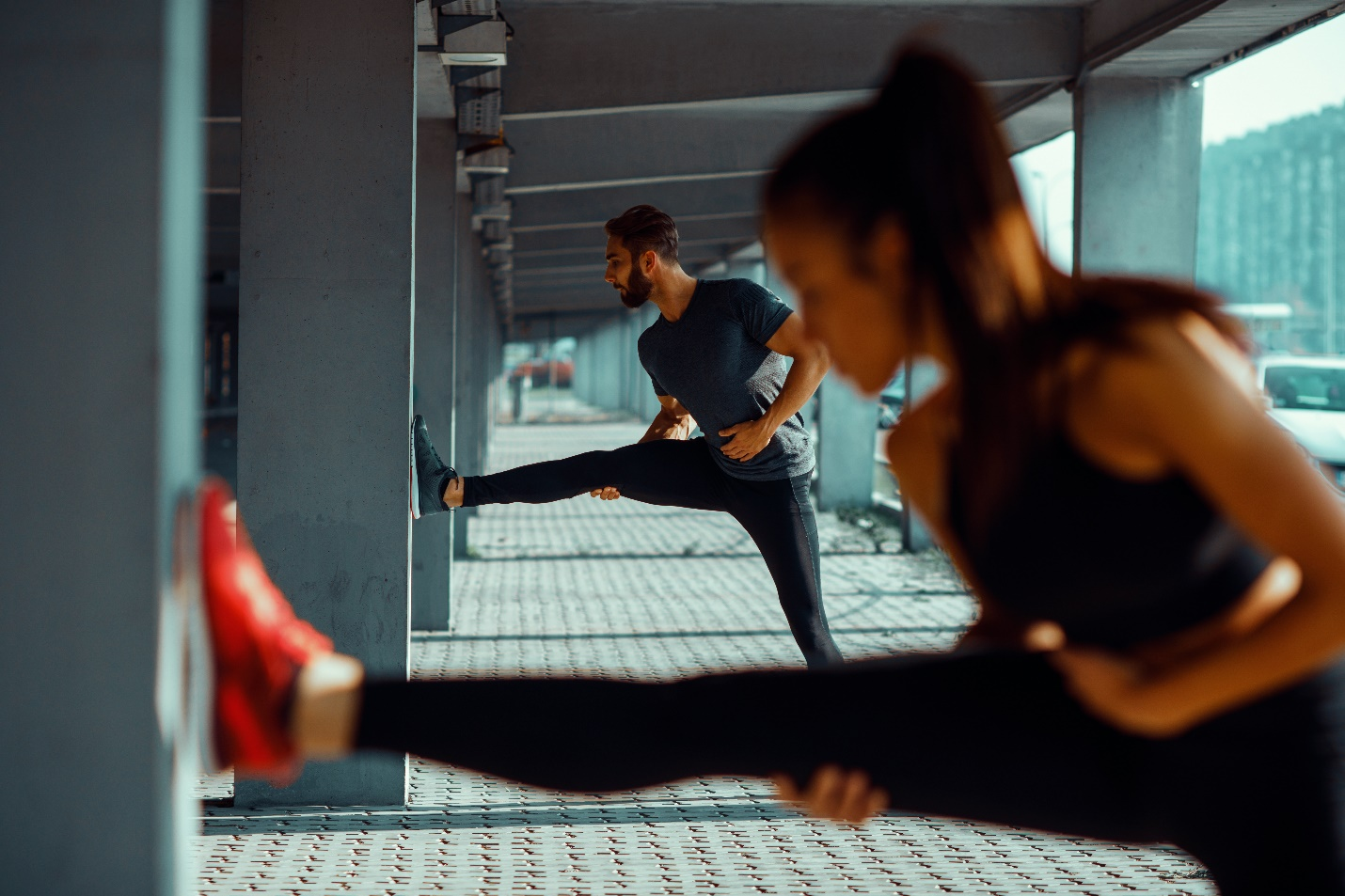 sports couple exercising in urban environment